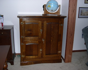 Old fashion ice box customized as entertainment cabinet.