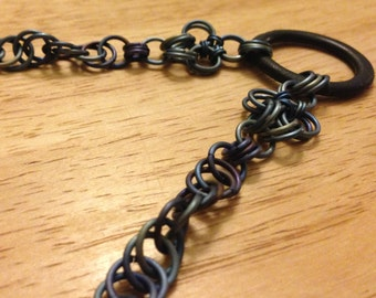 Blue Titanium Spiral Chainmaille Necklace With Ancient Celtic Artifact