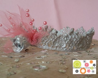 Sweet baby crown handcrafteded from silver lace and embellished with pink fluff.