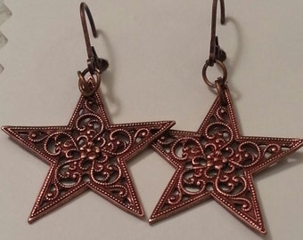 Copper stars dangle earrings