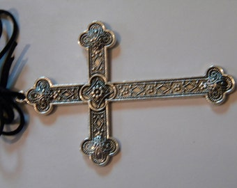 Large silver tone ornate cross