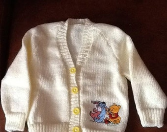 Cream hand Knitted baby cardigan with Winnie the Pooh embroidery