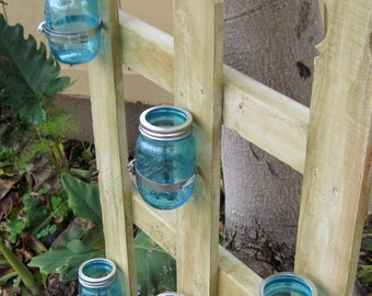 Picket Fence with Blue Mason Jars. Cottage Style Fence for any area in the home or garden.Use to float candles,or store just about Anything.