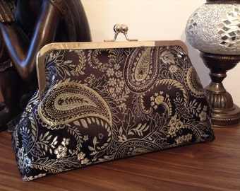 Give me feathers! Black, silver & gold paisley design clutch evening bag