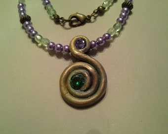 Bronze Clay amethyst and emerald cubic zirconia necklace