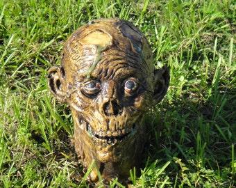 Zombie head ground popper!