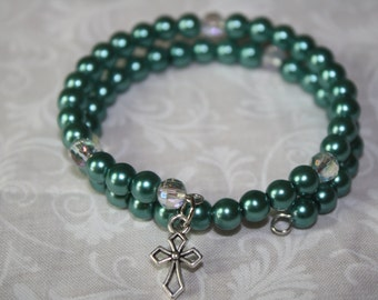 Memory Wire With Olive Green Glass Pearls and a Silver tone Cross.