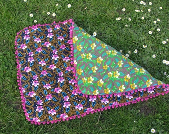 Vintage style double-sided floral baby mat with pom pom trimming