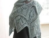 Hand knit shawl.