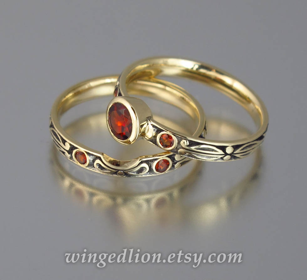 Garnet and diamond engagement rings