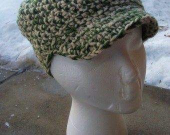 cream and green handmade crocheted adult hat with brim newsboy cap