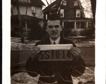 vintage Snapshot Abstract Criminal Guy Holds up License as Jail Booking Stunt