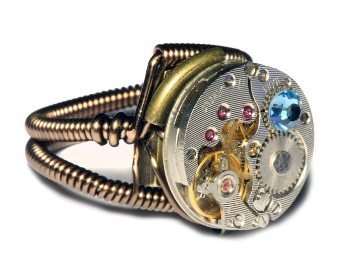 Steampunk ring, Steampunk Jewelry , Antique Watch Movement with Light Blue Crystal
