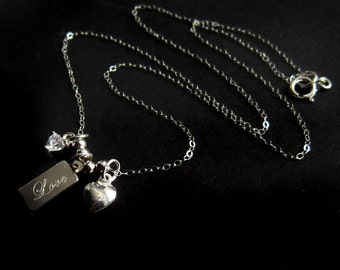 Sterling Silver Love Tag Necklace With Heart Charms and Cubic Zirconia