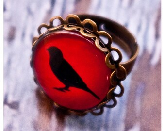 the black bird lenore: adjustable brass ring with black bird silhouette upon a field of scarlet