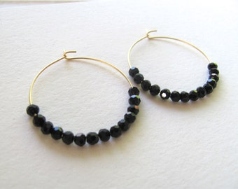 Gold hoop earrings with geometric black faceted beads, 16k gold plated hoops