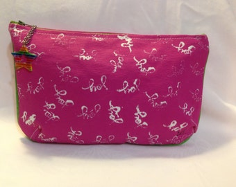 Clutch/purse hand painted in pink with the word JOY stamped on either side