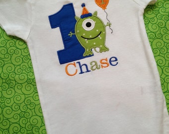 1st birthday monster bodysuit in green, blue, and orange
