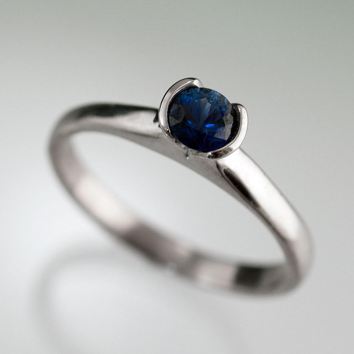 tulip blue sapphire engagement ring half bezel by