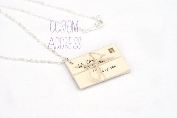 https://www.etsy.com/uk/listing/165732836/custom-address-envelope-necklace