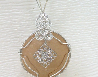 Translucent Mother of Pearl Shell with metal charm  wirewrapped  pendant