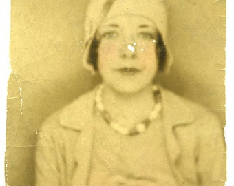 Tattered and worn 1920s Portrait of a Woman