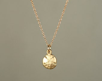 Gold sand dollar necklace - delicate necklace - a tiny 22k gold overlay gold sand dollar hanging from a 14k gold vermeil chain