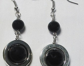 Black and Silver metal earrings with black bead in the center.