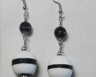 White and black earrings with horizontal stripe combined with a black bead.