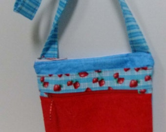 Turquoise and red crossover purse with many pocketsand zipper closure