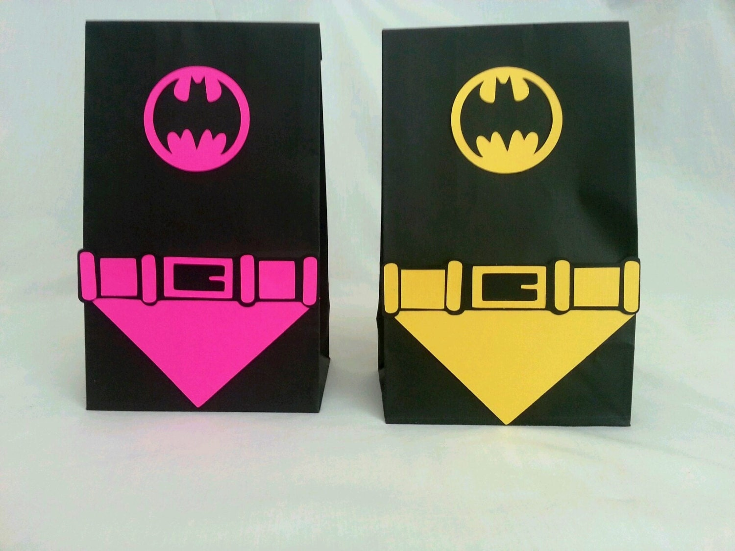 Batman or Batgirl party bags with capes and belts goodie