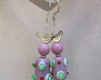 Lovely pink earrings with garnished handmade lampwork glass cylindrical bead and bird.