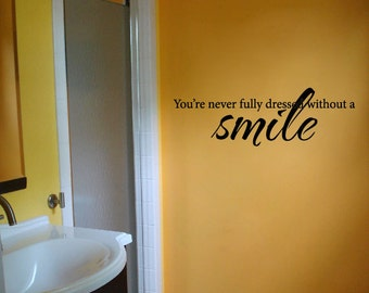 You're Never Fully Dressed Without a Smile Bedroom Wall Saying