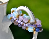 Set of three purple handmade beaded bracelets, designed and made from natural gemstones.