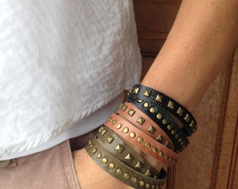Double wrap leather bracelet with brass pyramids and studs. Available in Black, Tan, Olive