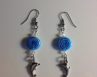 Blue glass and dolphin drop earrings