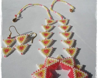 Set consisting of necklace and earrings in weaving beaded white, yellow and orange
