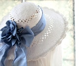 Gold straw hat with wide ribbon bowknot.