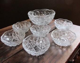 Pressed glass berry bowl set - 7 pieces - Sawtooth edges - ornate design 1940s