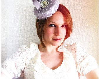 Violet Breeze small purple cocktail hat/ races hat with spot veil and green flowers