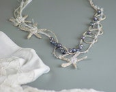 Fine art pearl jewelry with sea stars for beach wedding. Mermaid bride wedding textile necklace with gray black pearls.