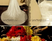 Vintage Inspired Lace Wedding Dress Features Cap Sleeves Full Lace Covered Back and Ribbon on the Waistline