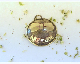 Bowties are cool. Doctor Who pendant. Etched brass. Handmade. perfect gift for a Doctor Who fan