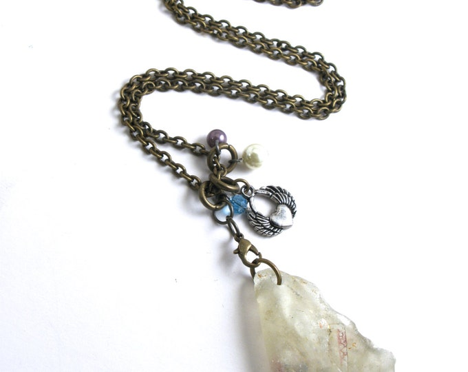 Large White Folded Bonfire Sea Glass with Inclusions on a Charm Necklace with a Winged Heart, Pearls and Crystals on an Antique Brass Chain