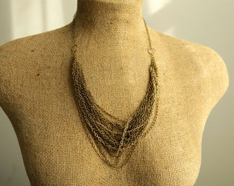layered statement necklace with multi chains in gold bronze steel