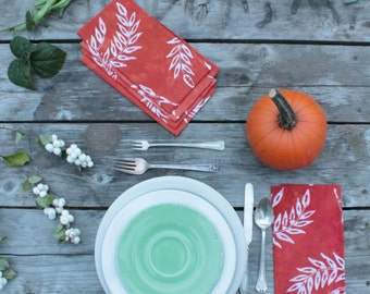 spiced persimmon batik napkins in wheat print. made to order