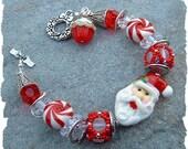 Santa Claus and Candycanes- Christmas Lampwork Bead Bracelet