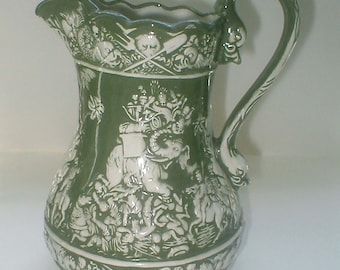 Embossed Ceramic Pottery Pitcher - Vintage 1890s - Olive Green and White Elephants and Warriors