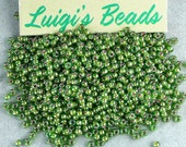 11/0 Round TOHO Glass Seed Beads #1046- Luster Peridot/Opaque White Lined 15g