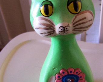 adorable green plaster cat bank